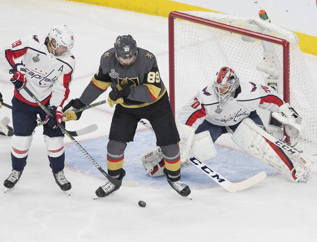 Capitals goaltender Braden Holtby (70) makes a first-period save against Golden Knights right wing Alex Tuch (89) during Game 5 of the NHL Stanley Cup Final on Thursday, June 7, 2018, at T-Mobile ...