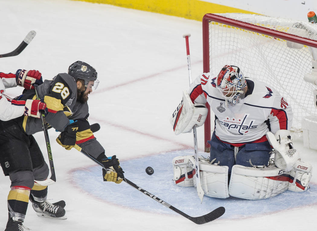 Golden Knights left wing William Carrier (28) shoots on Capitals goaltender Braden Holtby (70) in the first period during Game 5 of the NHL Stanley Cup Final on Thursday, June 7, 2018, at T-Mobile ...