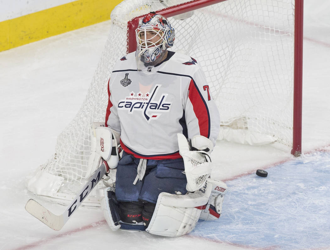 Capitals goaltender Braden Holtby (70) gives up a second period goal to Golden Knights right wing Reilly Smith (19) during Game 5 of the NHL Stanley Cup Final on Thursday, June 7, 2018, at T-Mobi ...