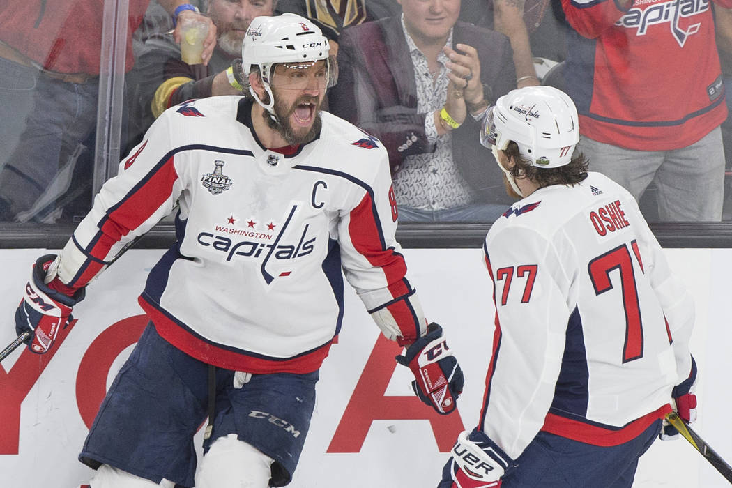 Capitals left wing Alex Ovechkin (8) celebrates with right wing T.J. Oshie (77) after Ovechkin scored a second-period goal during Game 5 of the NHL Stanley Cup Final against the Golden Knights on ...