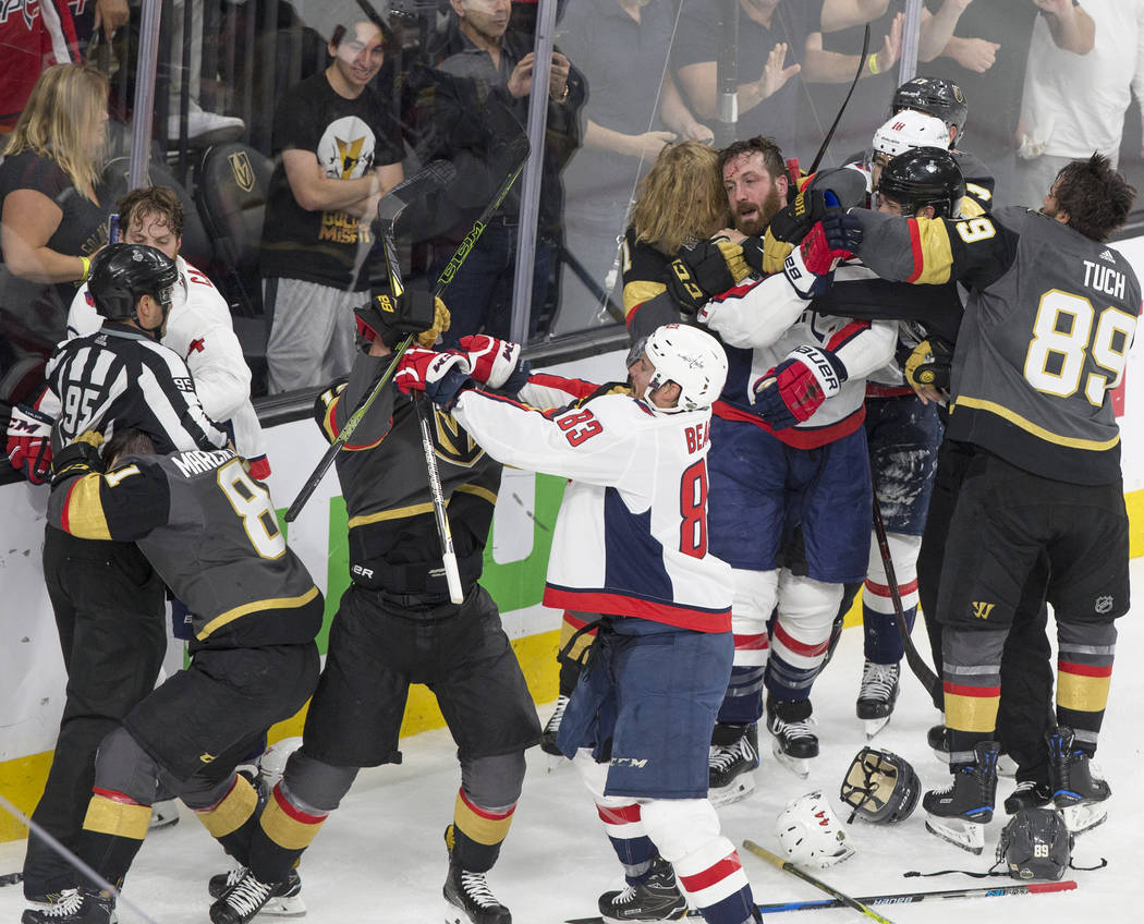 The Golden Knights and Washington Capitals scuffle in the second period during Game 5 of the NHL Stanley Cup Final on Thursday, June 7, 2018, at T-Mobile Arena, in Las Vegas. Benjamin Hager Las Ve ...