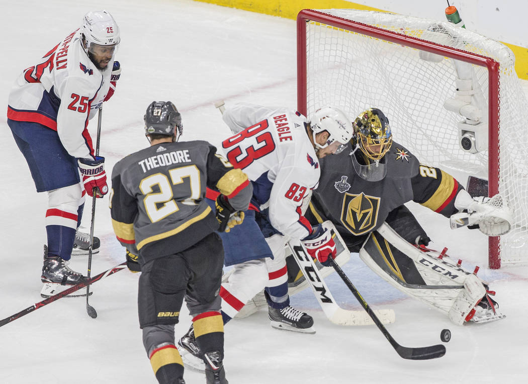 Golden Knights goaltender Marc-Andre Fleury (29) makes a save against Capitals right wing Jay Beagle (83) in the second period during Game 5 of the NHL Stanley Cup Final on Thursday, June 7, 2018, ...