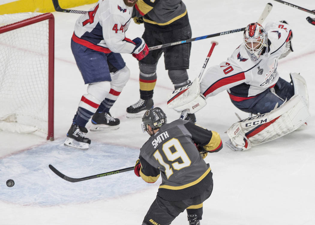 Golden Knights right wing Reilly Smith (19) scores a second-period goal against Capitals goaltender Braden Holtby (70) during Game 5 of the NHL Stanley Cup Final on Thursday, June 7, 2018, at T-Mo ...
