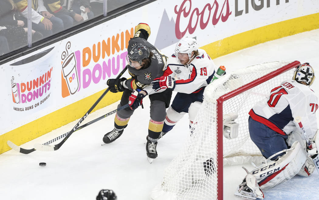 Vegas Golden Knights left wing Erik Haula (56) and Washington Capitals center Nicklas Backstrom (19) vie for the puck as Capitals goaltender Braden Holtby (70) protects his net during the first pe ...