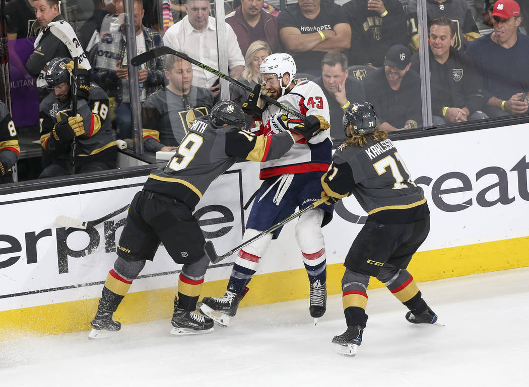 Vegas Golden Knights right wing Reilly Smith (19) and center William Karlsson (71) check Washington Capitals right wing Tom Wilson (43) during the second period of Game 5 of the NHL hockey Stanley ...
