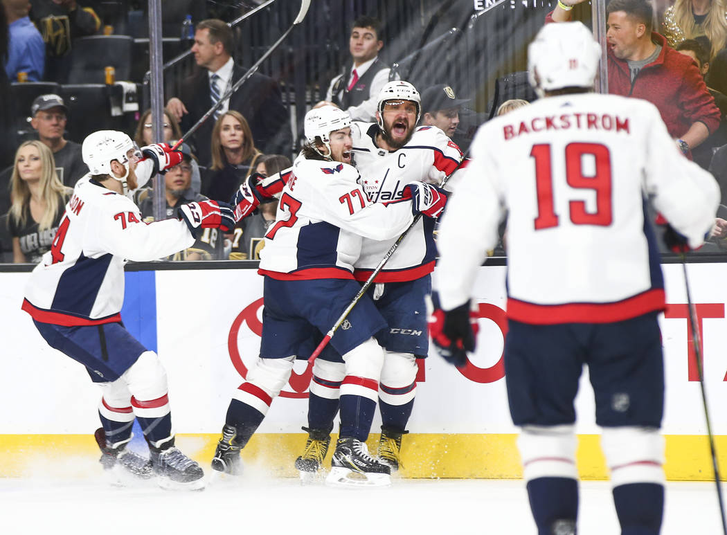 Washington Capitals players celebrate a goal by Washington Capitals left wing Alex Ovechkin, third from left, during the second period of Game 5 of the Stanley Cup Final against the Golden Knights ...
