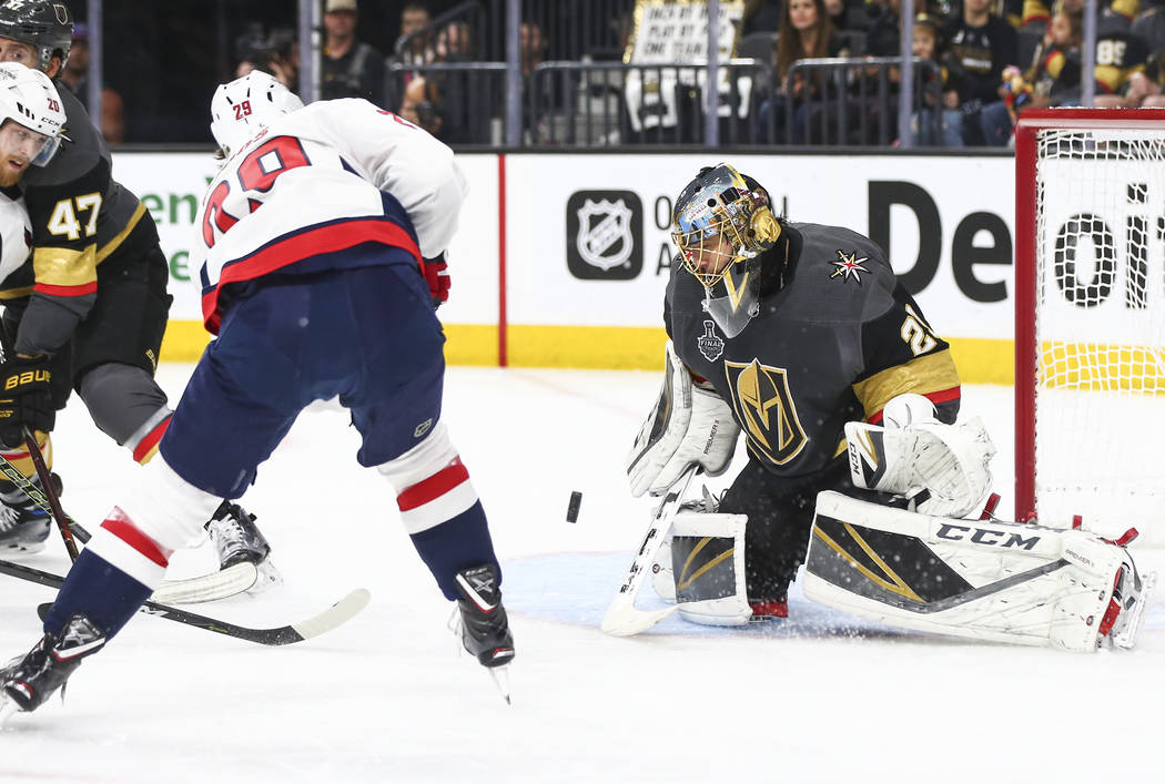 Golden Knights goaltender Marc-Andre Fleury (29) blocks a shot from Washington Capitals defenseman Christian Djoos (29) during the second period of Game 5 of the Stanley Cup Final at T-Mobile Aren ...