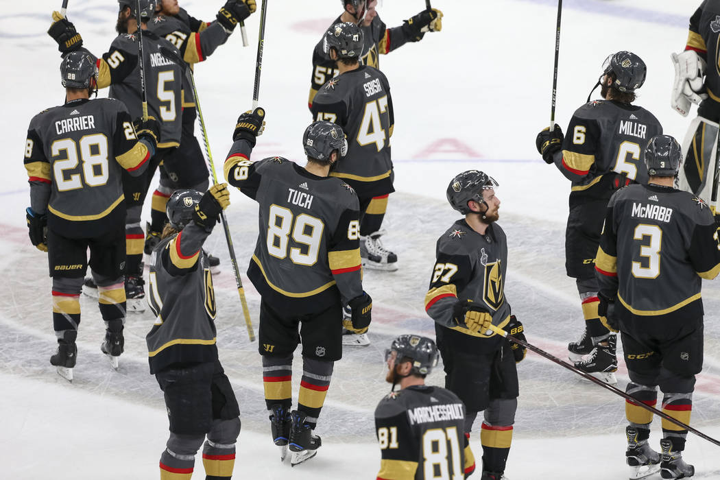 Members of the Vegas Golden Knights acknowledge the crowd after their 4-3 loss to the Washington Capitals in Game 5 of the NHL hockey Stanley Cup Final at T-Mobile Arena in Las Vegas on Thursday, ...