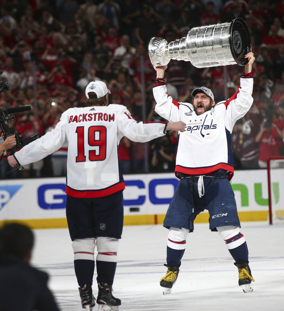 Washington Capitals left wing Alex Ovechkin (8) and center Nicklas Backstrom (19) celebrates after defeating the Golden Knights in Game 5 of the Stanley Cup Final to win the series at T-Mobile Are ...