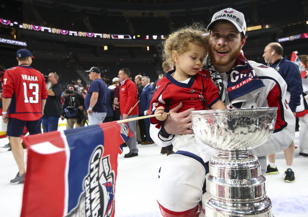 Washington Capitals defenseman John Carlson (74) with celebrates with his daughter after defeating the Golden Knights in Game 5 to win the Stanley Cup Final at T-Mobile Arena in Las Vegas on Thurs ...