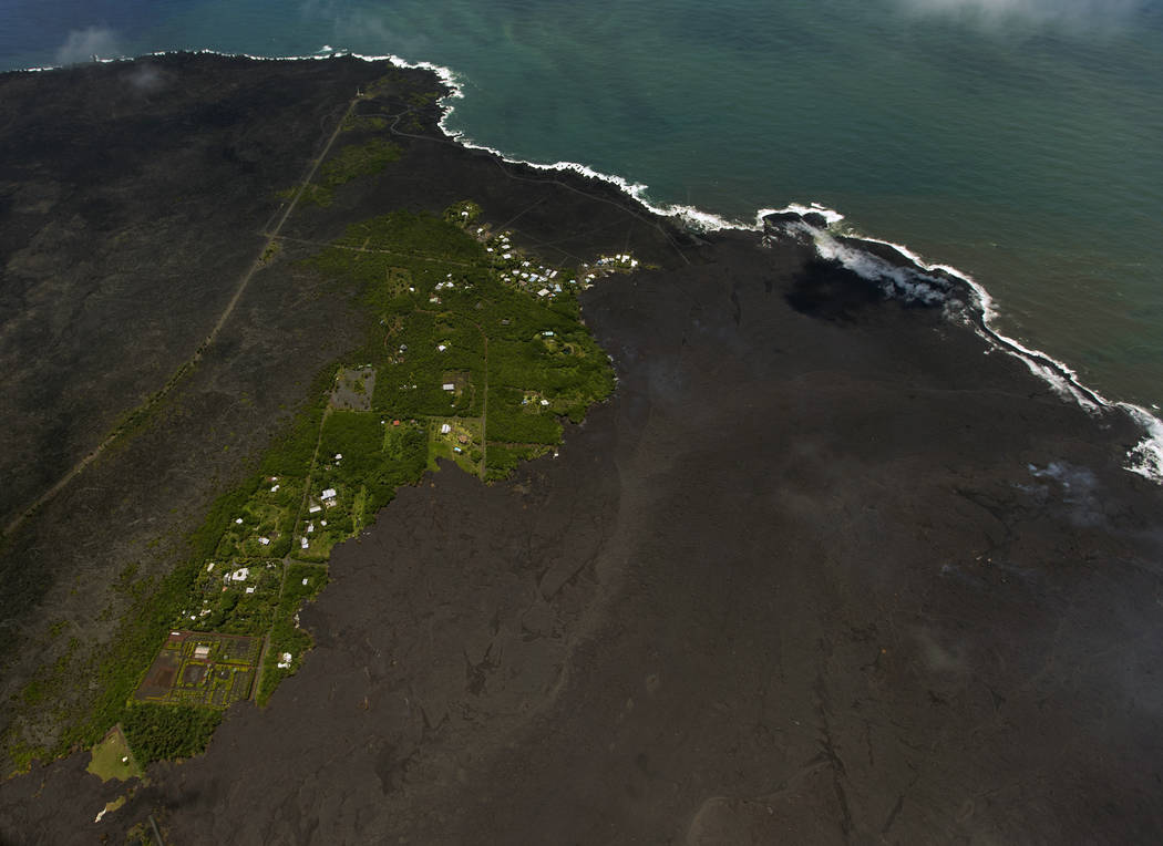 Volcanic lava buries two housing tracts on Hawaii's Big…
