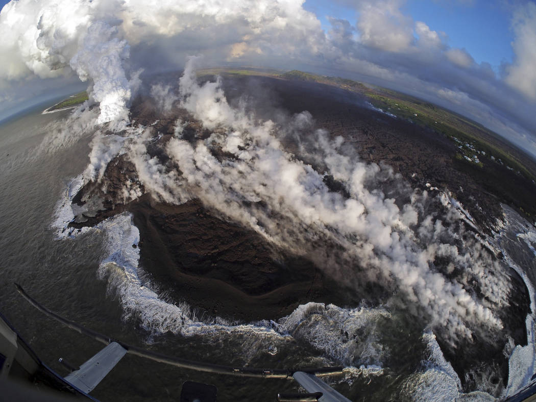 This Wednesday, June 6, 2018 photo from the U.S. Geological Survey shows a fish-eye view of a lava delta filling the former Kapoho Bay at the town of Kapoho on the island of Hawaii. While the delt ...