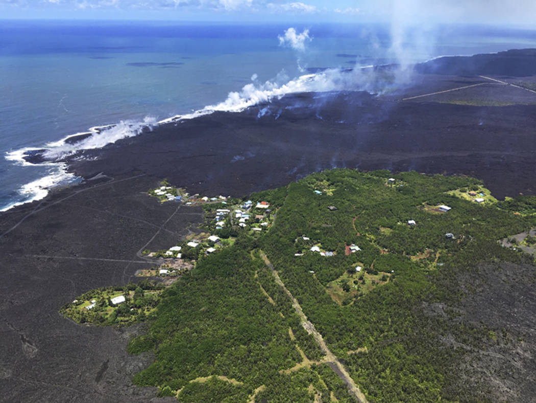 This Wednesday, June 6, 2018 photo from the U.S. Geological Survey shows the remains of the Kapoho Beach Lots subdivision and a fissure flow front at the town of Kapoho on the island of Hawaii. Ka ...