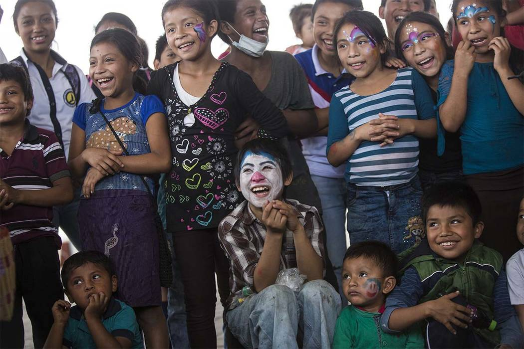 """Children who survived the eruption of the Volcan de Fuego or """"Volcano of Fire"""" are entertained by a clown near a shelter in Alotenango, Guatemala, Thursday, June 7, 2018. Guatemalan pros ..."""