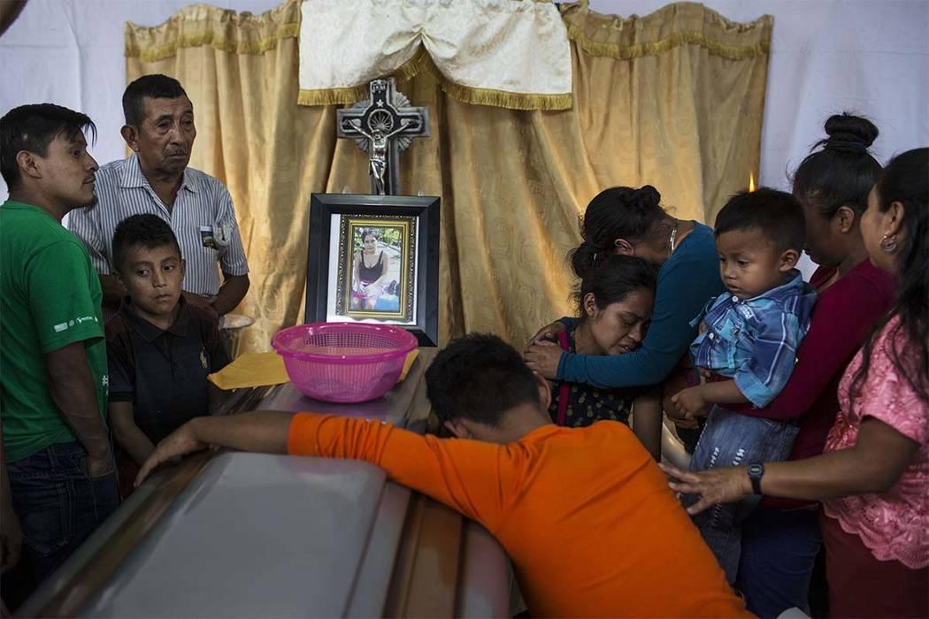 Relatives mourn Maritza Nij Ramos Davila, 40, during her wake in Alotenango, Guatemala, Thursday, June 7, 2018. Guatemalan prosecutors have ordered an investigation into whether evacuation protoco ...