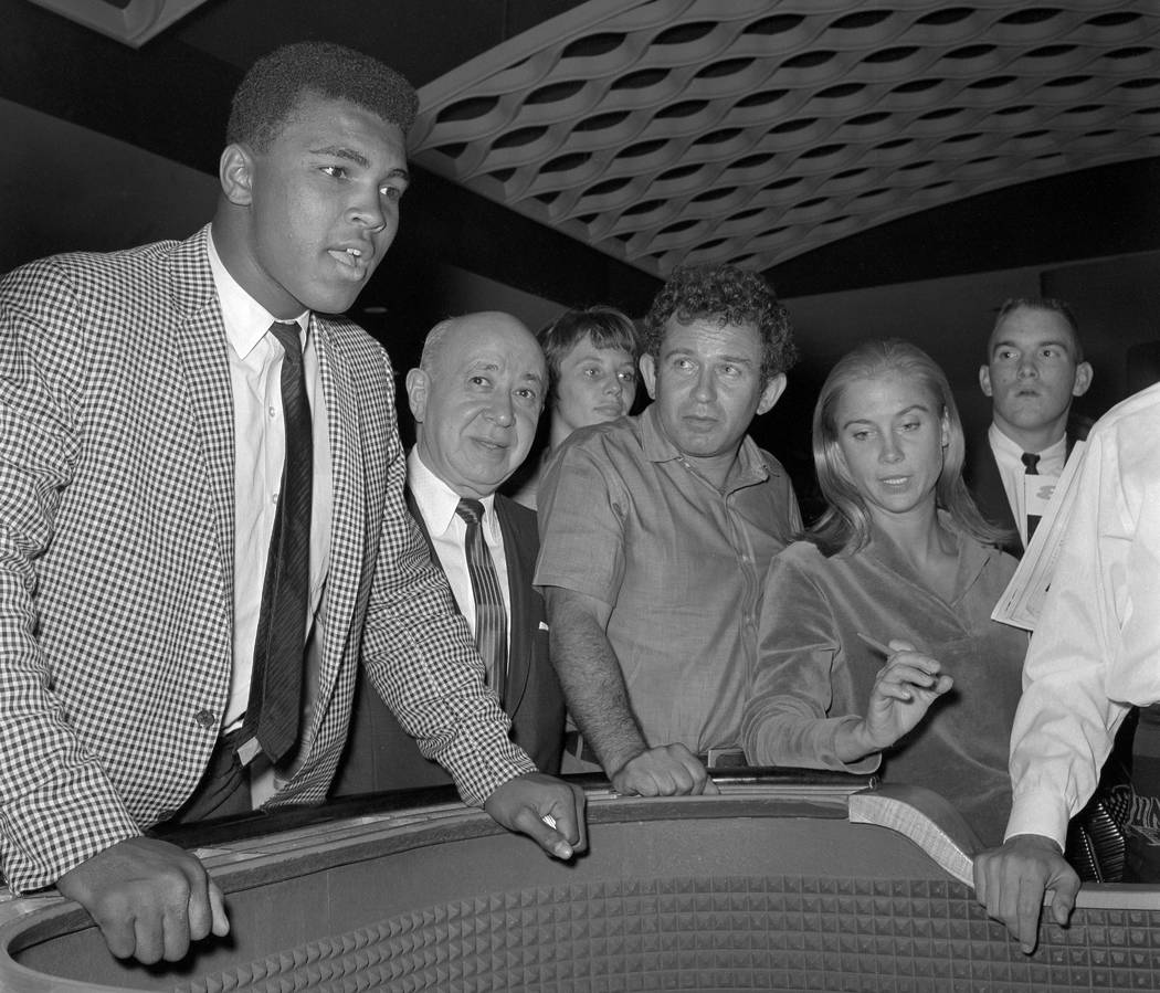 Cassius Clay, who would later change his name to Muhammad Ali, is seen at a craps table at the Dunes in Las Vegas Wednesday, July 17, 1963. (Jerry Abbott/Las Vegas News Bureau)
