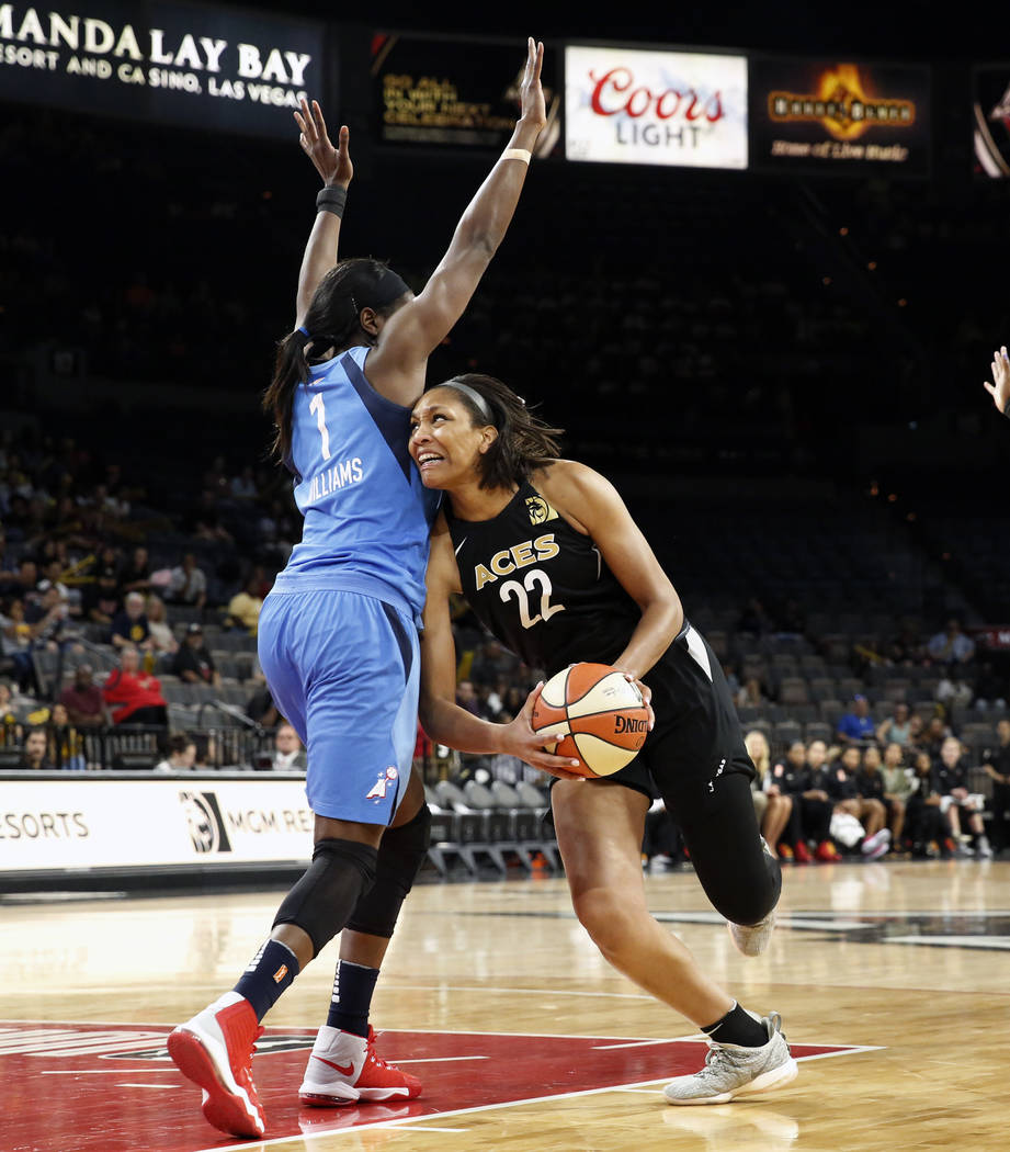 Las Vegas Aces center A'ja Wilson (22) drives past Atlanta Dreams's Elizabeth Williams (1) in the first half of a WNBA basketball game at the Mandalay Bay Event Center in Las Vegas on Friday, June ...
