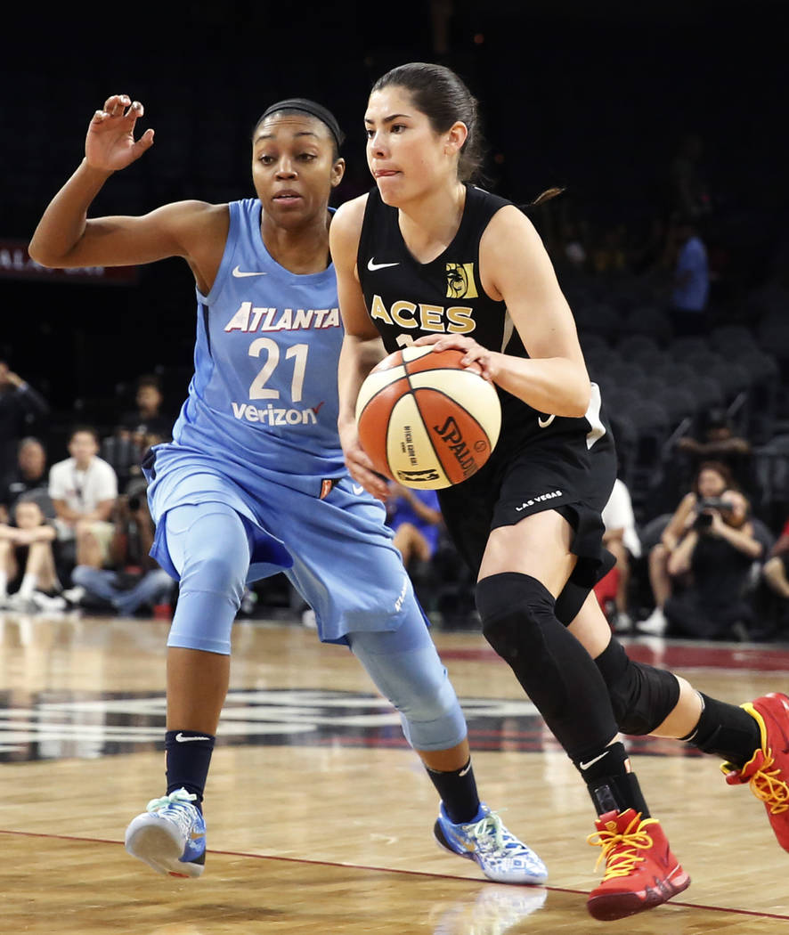 Las Vegas Aces guard Kelsey Plum (10) drives past Atlanta Dreams's Renee Montgomery (21) in the first half of a WNBA basketball game at the Mandalay Bay Event Center in Las Vegas on Friday, June 8 ...