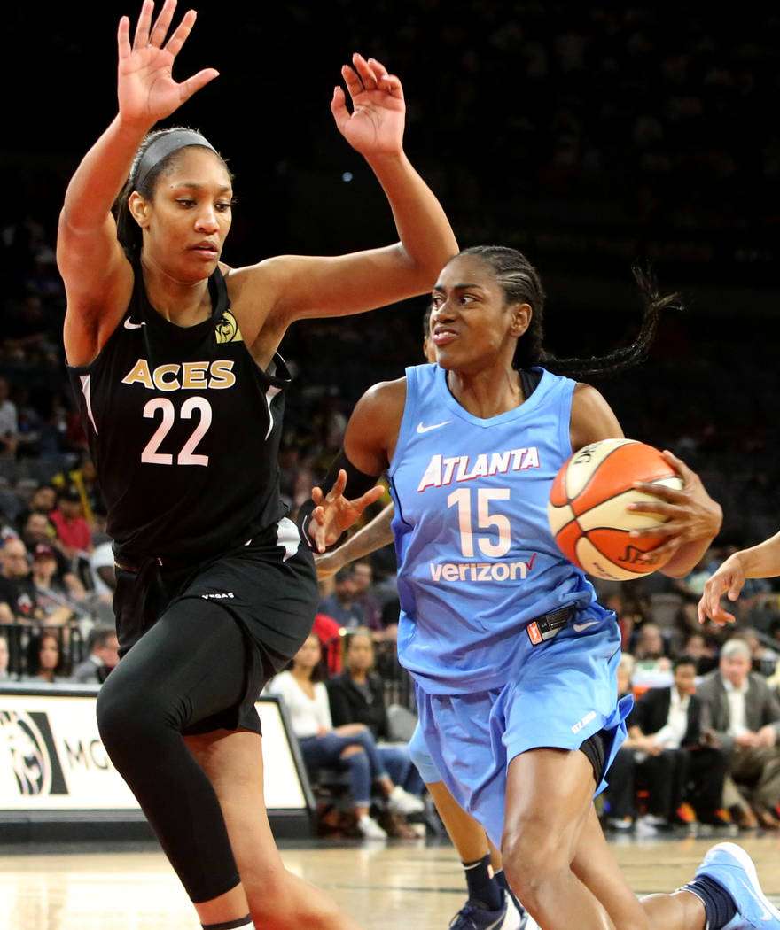 Las Vegas Aces A'ja Wilson (22) defends Atlanta Dreams's Tiffany Hayes (15) in the second half of a WNBA basketball game at the Mandalay Bay Event Center in Las Vegas on Friday, June 8, 2018. Bizu ...