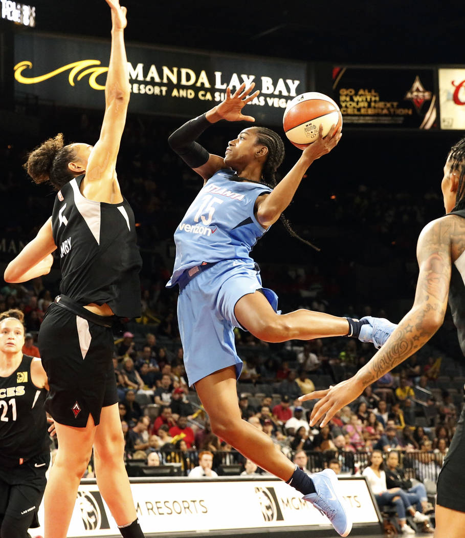 Las Vegas Aces Dearica Hamby, left, tries to block Atlanta Dreams Tiffany Hayes' (15) shot in the second half of a WNBA basketball game at the Mandalay Bay Event Center in Las Vegas on Friday, Jun ...
