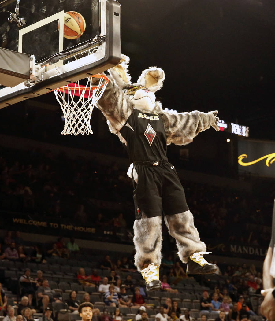Las Vegas Aces mascot Bucket$ tries to block a contester shot in the second half of a WNBA basketball game at the Mandalay Bay Event Center in Las Vegas on Friday, June 8, 2018. Bizuayehu Tesfaye/ ...
