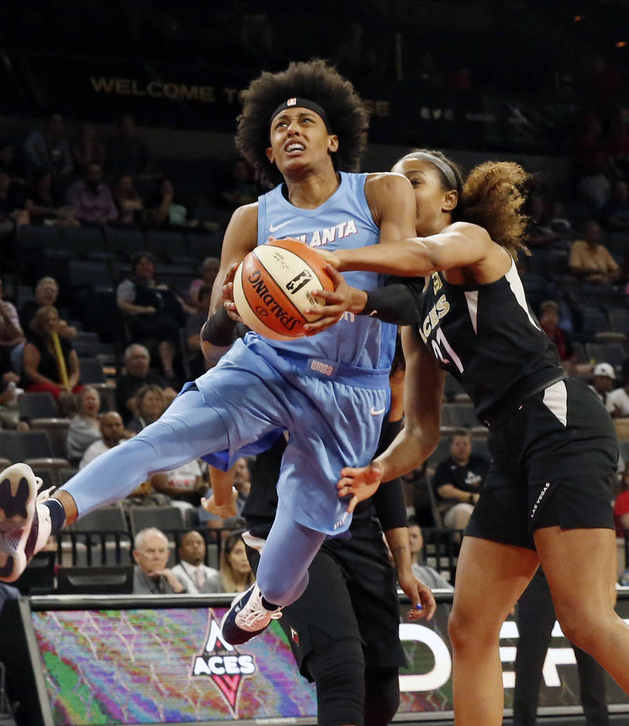 Las Vegas Aces Kayla McBride (21) fouls Atlanta Dreams's Brittney Sykes (7) in the second half of a WNBA basketball game at the Mandalay Bay Event Center in Las Vegas on Friday, June 8, 2018. Bizu ...