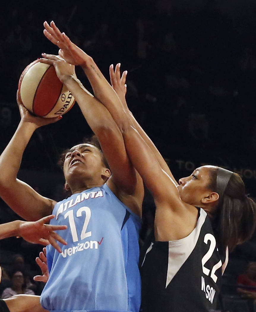 Las Vegas Aces A'ja Wilson (22) goes for a rebound against Atlanta Dreams's Damiris Dantas (12) in the second half of a WNBA basketball game at the Mandalay Bay Event Center in Las Vegas on Friday ...