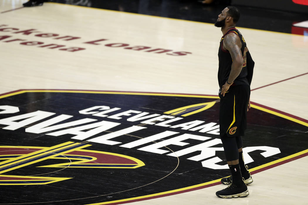 Cleveland Cavaliers' LeBron James watches during the first half of Game 4 of basketball's NBA Finals against the Golden State Warriors, Friday, June 8, 2018, in Cleveland. (AP Photo/Tony Dejak)