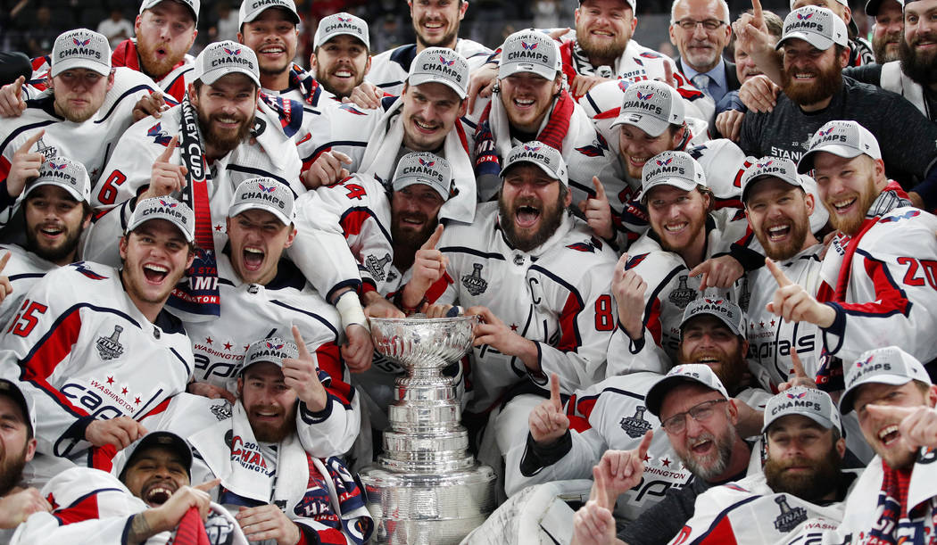 Members of the Washington Capitals pose with the Stanley Cup after the Capitals defeated the Golden Knights 4-3 in Game 5 of the NHL hockey Stanley Cup Finals Thursday, June 7, 2018, in Las Vegas. ...