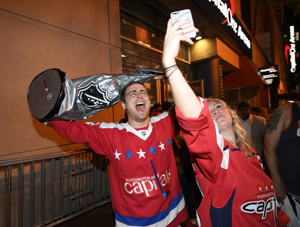 Washington Capitals fans celebrate in the streets outside Capital One Arena in Washington after Game 5 of the NHL hockey Stanley Cup Final between the Washington Capitals and the Vegas Golden Knig ...