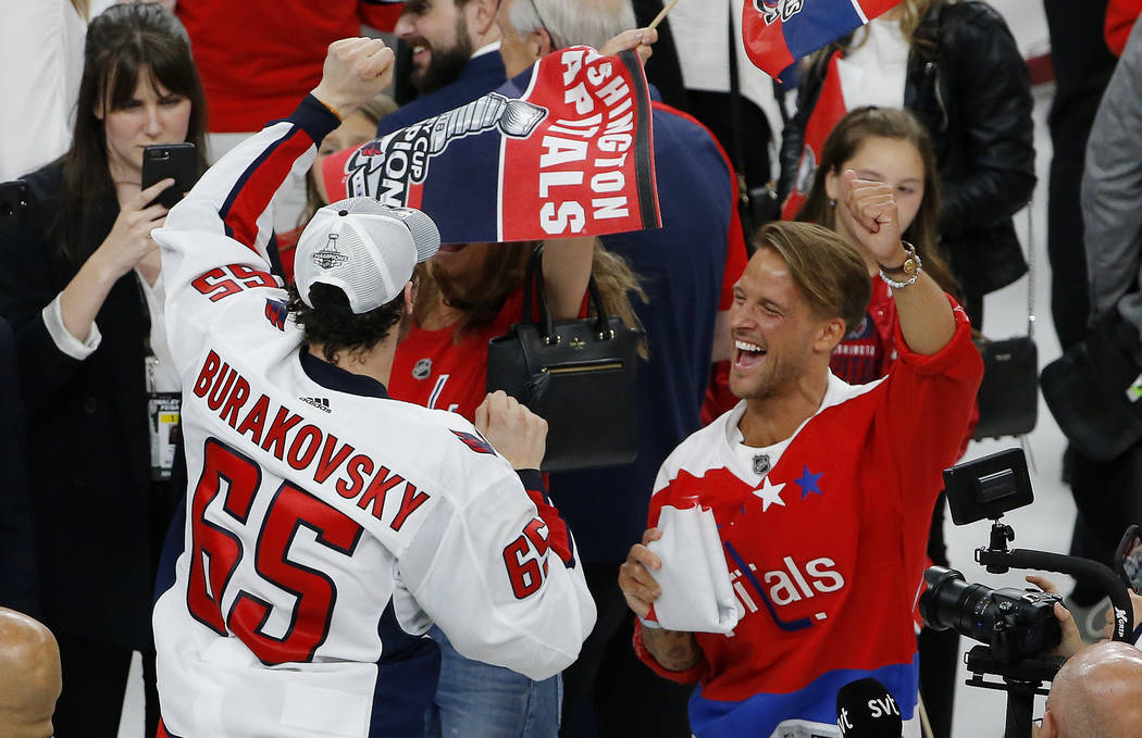 Washington Capitals' Andre Burakovsky (65) celebrates on the ice after the Capitals defeated the Vegas Golden Knights in Game 5 of the NHL hockey Stanley Cup Finals Thursday, June 7, 2018, in Las ...