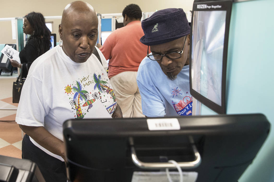 Ida Horne, left, gets assistance voting from volunteer Leonard Green at the Doolittle Community Center on Friday, June 8, 2018, in Las Vegas. Benjamin Hager Las Vegas Review-Journal @benjaminhphoto
