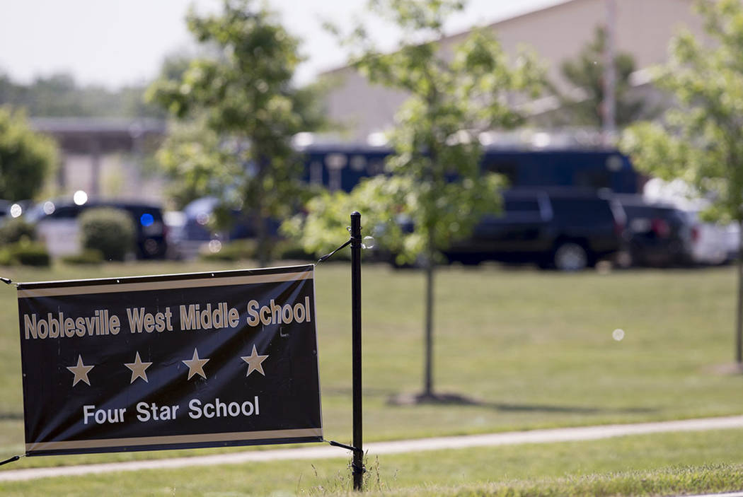 Law enforcement vehicles are seen behind a school sign after a shooting at Noblesville West Middle School in Noblesville, Ind., last month. (Robert Scheer/The Indianapolis Star via AP, File)