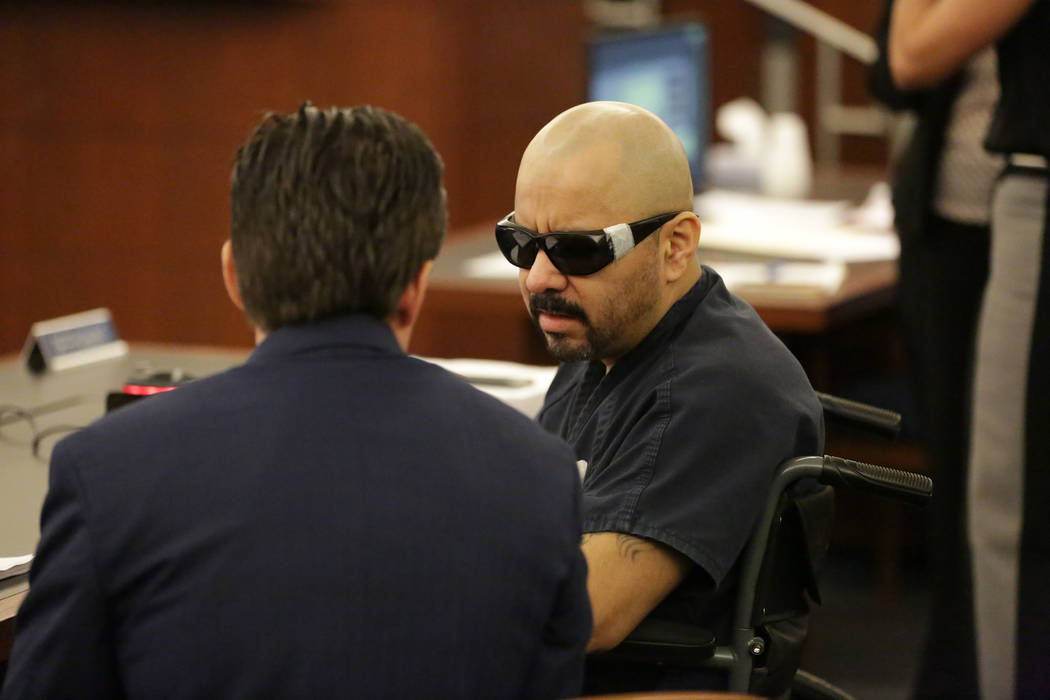 Gustavo Ramos-Martinez, who has been jailed for eight years in the double murder of two people more than 20 years ago, speaks with his attorney Abel Yanez during a court appearance on Friday, June ...