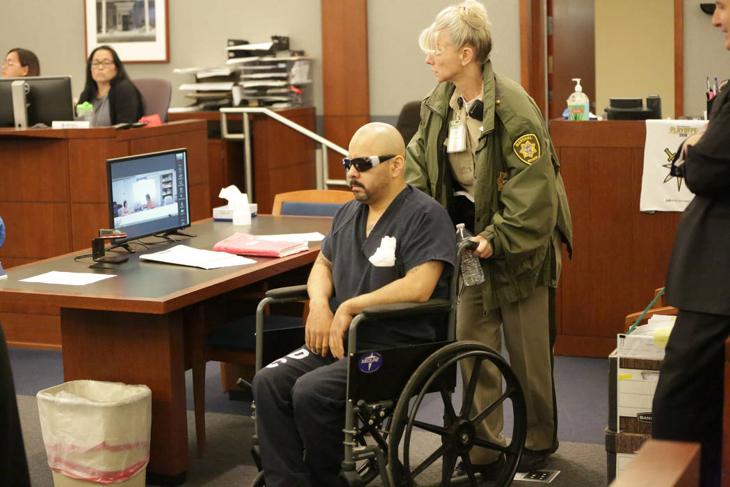 Gustavo Ramos-Martinez, who has been jailed for eight years in the double murder of two people more than 20 years ago, is pushed into court by Marshall Robin Quarnstrom on Friday, June 8, 2018. Mi ...