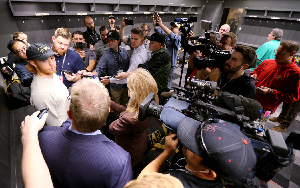 Vegas Golden Knights center Cody Eakin, left, talks to the news media at City National Arena Friday, June 8, 2018, after falling to the Washington Capitals in the Stanley Cup Final Thursday. K.M. ...