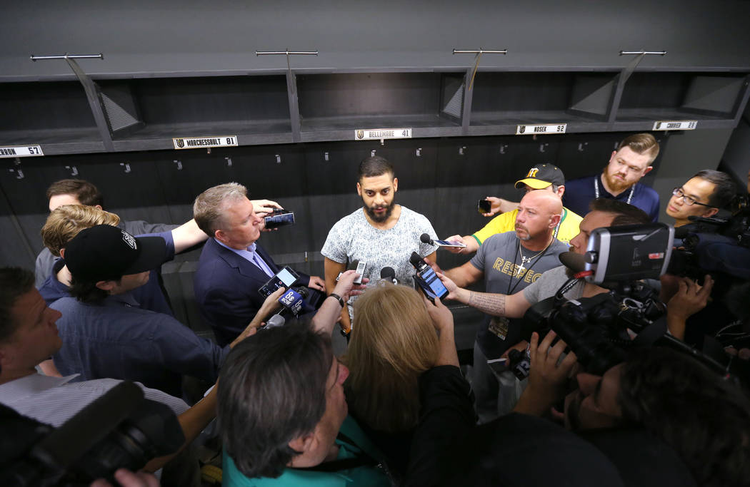 Vegas Golden Knights center Pierre-Edouard Bellemare, center, talks to the news media at City National Arena Friday, June 8, 2018, after falling to the Washington Capitals in the Stanley Cup Final ...