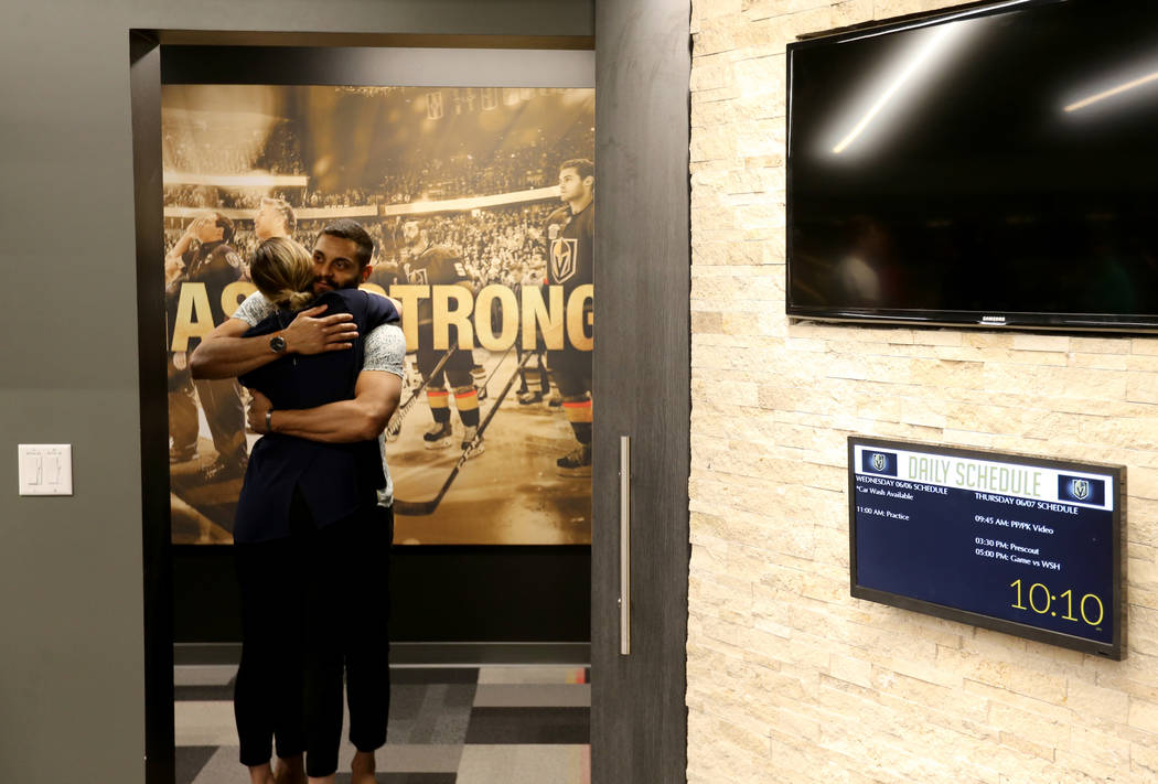 Vegas Golden Knights center Pierre-Edouard Bellemare, hugs Alyssa Giradi, senior manager of communications and content, at City National Arena Friday, June 8, 2018, after falling to the Washington ...