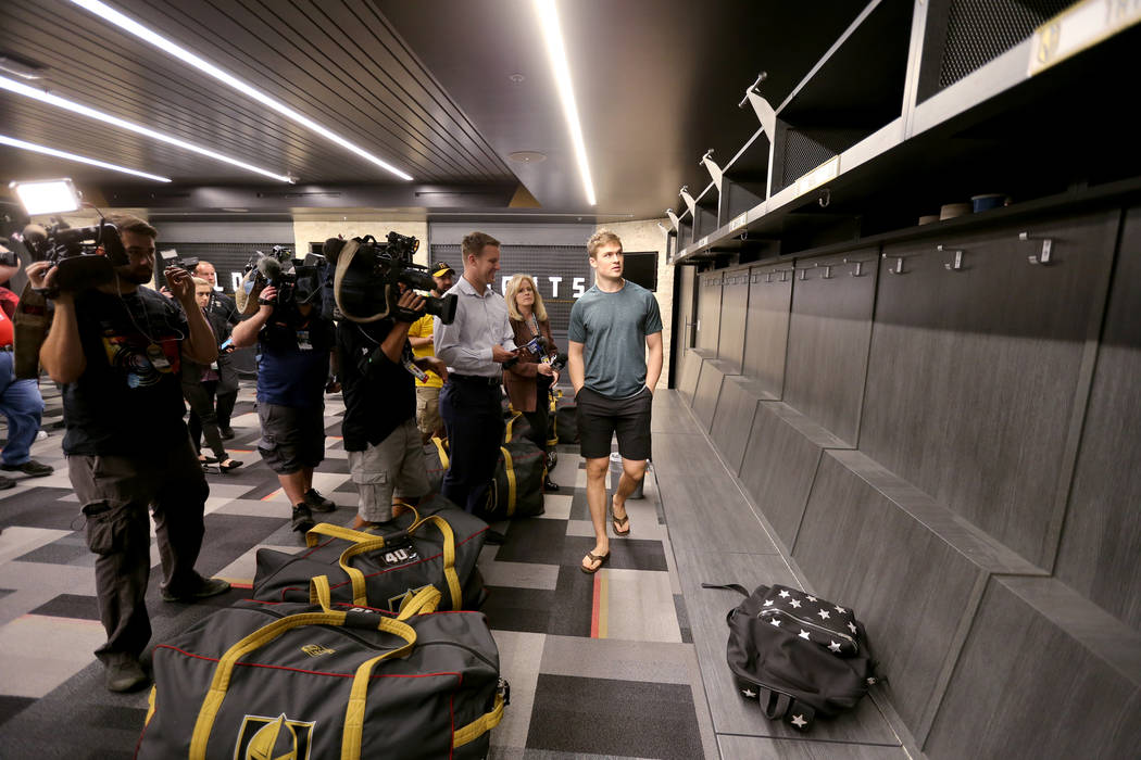 Vegas Golden Knights center Ryan Carpenter, right, glances at his locker at City National Arena Friday, June 8, 2018, after falling to the Washington Capitals in the Stanley Cup Final Thursday. K. ...