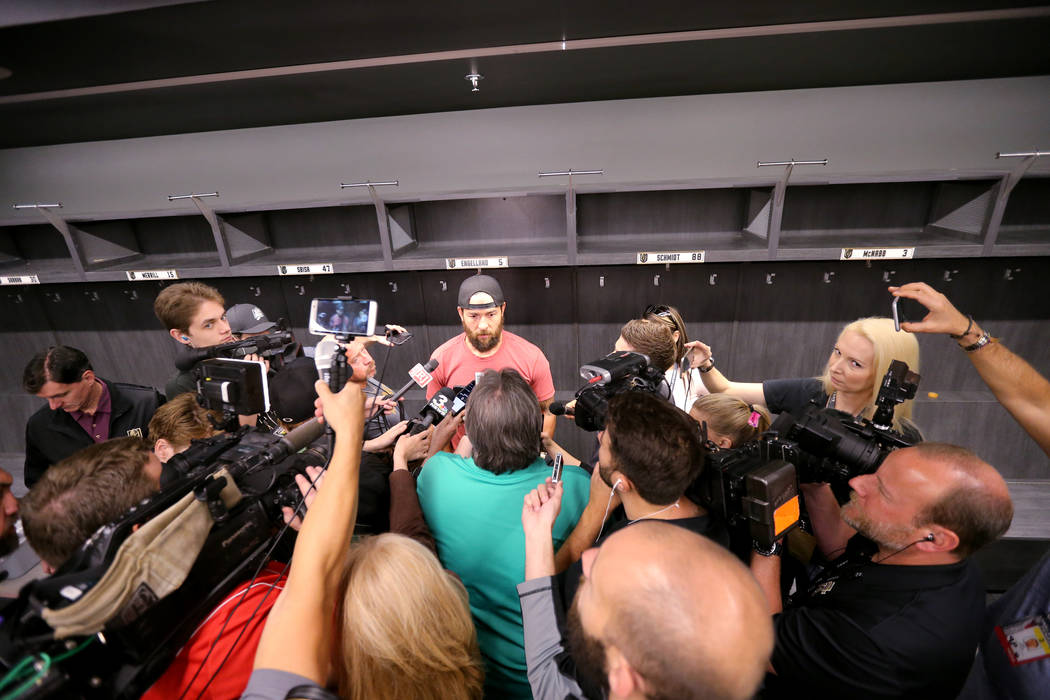 Vegas Golden Knights defenseman Deryk Engelland, center, talks to the news media at City National Arena Friday, June 8, 2018, after falling to the Washington Capitals in the Stanley Cup Final Thur ...