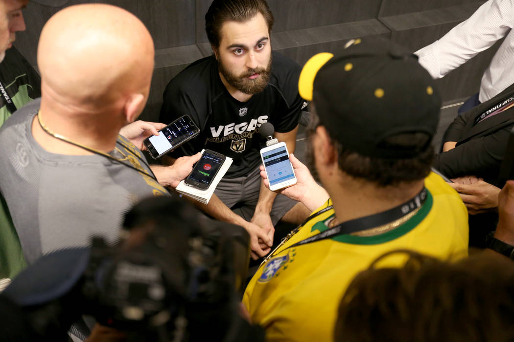 Vegas Golden Knights forward Alex Tuch, center, talks to the news media at City National Arena Friday, June 8, 2018, after falling to the Washington Capitals in the Stanley Cup Final Thursday. K.M ...