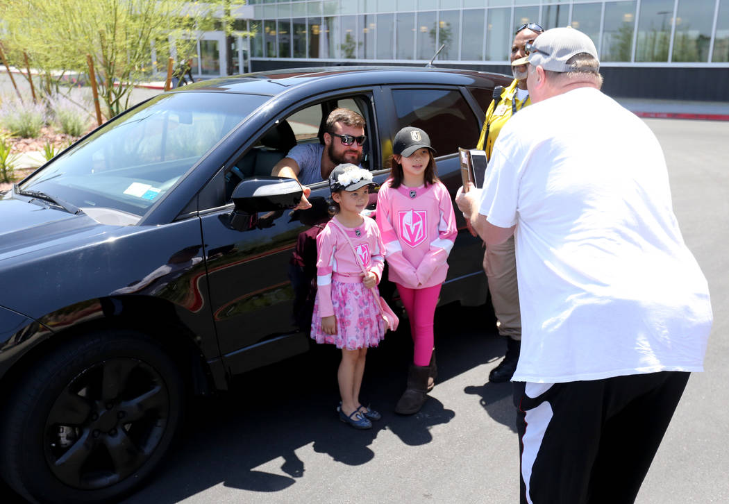 Todd Young takes a photo of his daughters Bailey, 6, and Gracie, 8, with Vegas Golden Knights forward William Carrier at City National Arena Friday, June 8, 2018, after after the Knights fell to t ...