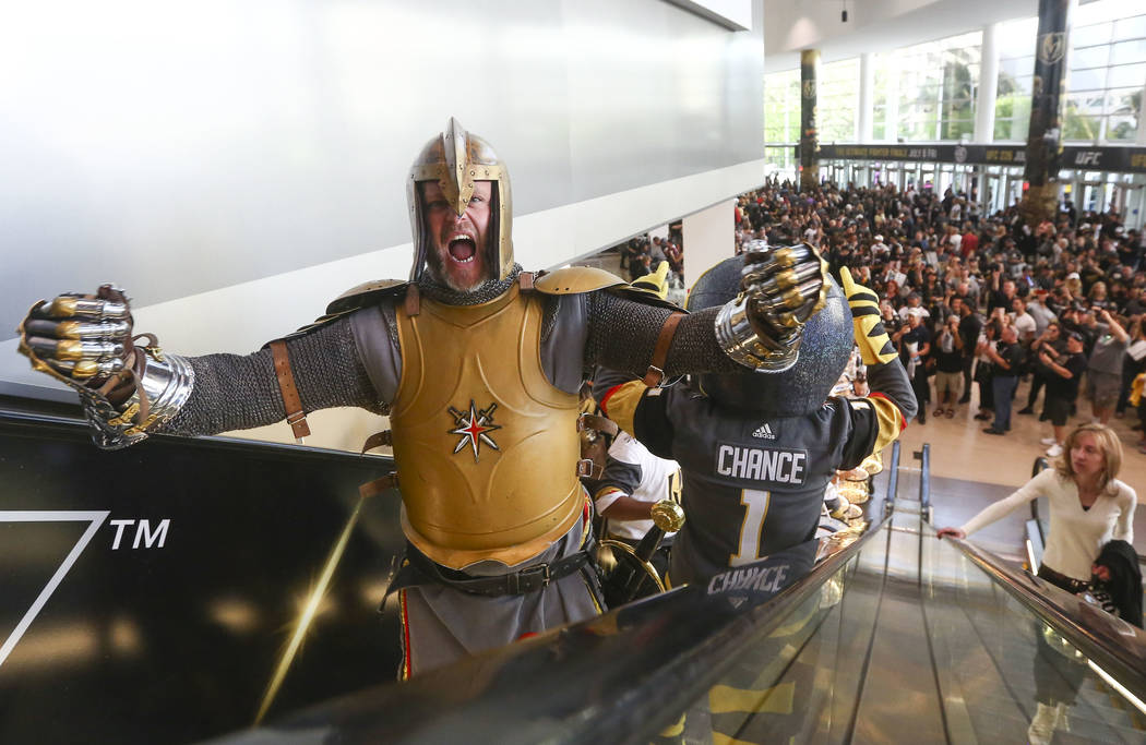 The Golden Knight reacts as the Knight Line and Chance the mascot entertain fans before the start of Game 2 of an NHL hockey second-round playoff series at T-Mobile Arena in Las Vegas on Saturday, ...