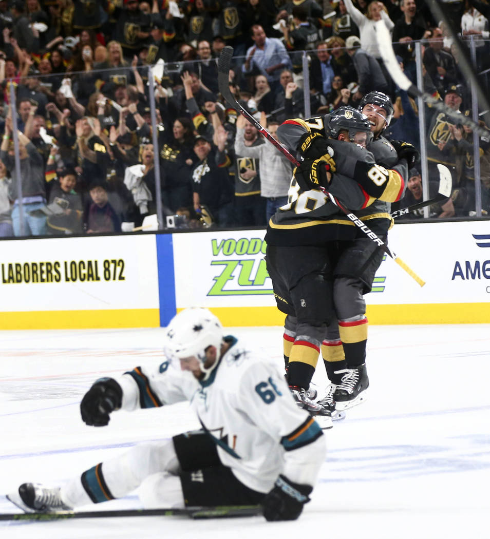 Golden Knights defenseman Nate Schmidt, left, celebrates his goal with defenseman Shea Theodore (27) during the third period of Game 2 of an NHL hockey second-round playoff series against the San ...