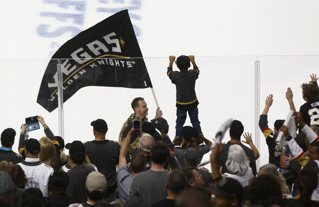 Golden Knights fans celebrate a 7-0 win over the San Jose Sharks in Game 1 of an NHL hockey second-round playoff series at T-Mobile Arena in Las Vegas on Thursday, April 26, 2018. Chase Stevens La ...