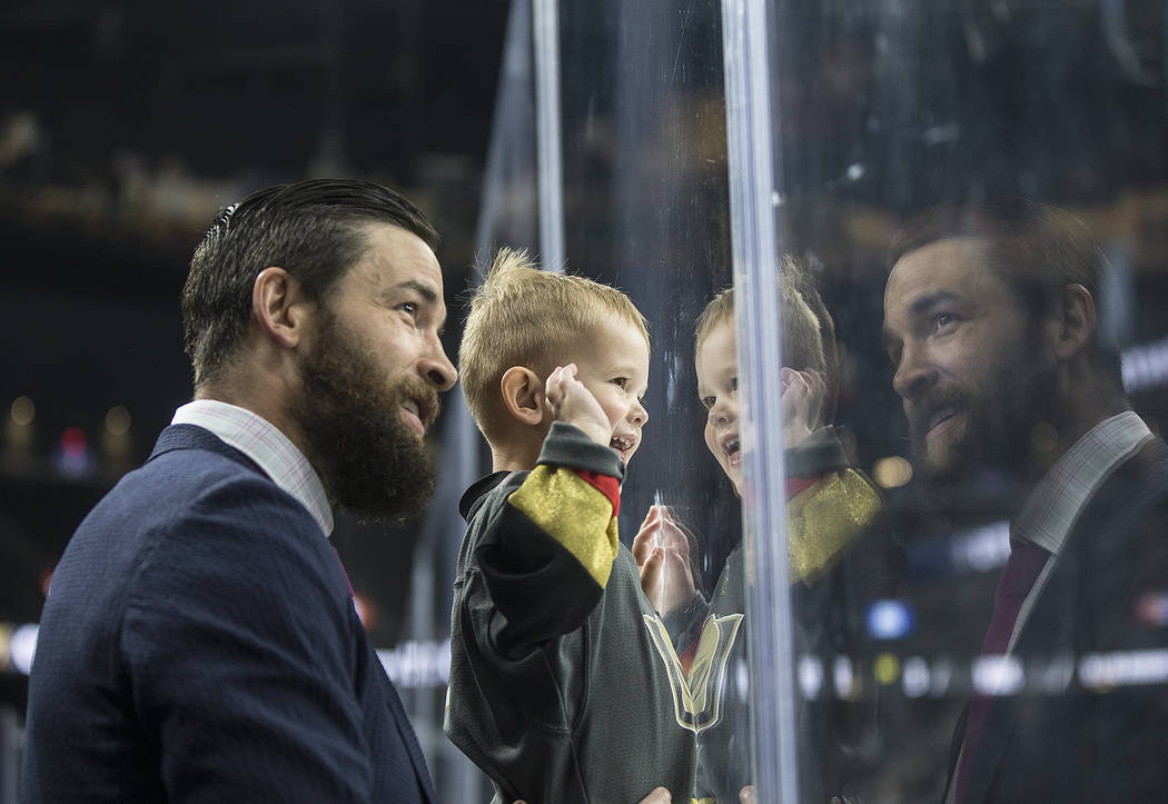 Golden Knights defenseman Deryk Engelland holds his son up on the glass to watch the zamboni after game four of Las Vegas' NHL Western Conference Finals matchup with Winnipeg on Friday, May 18, 20 ...