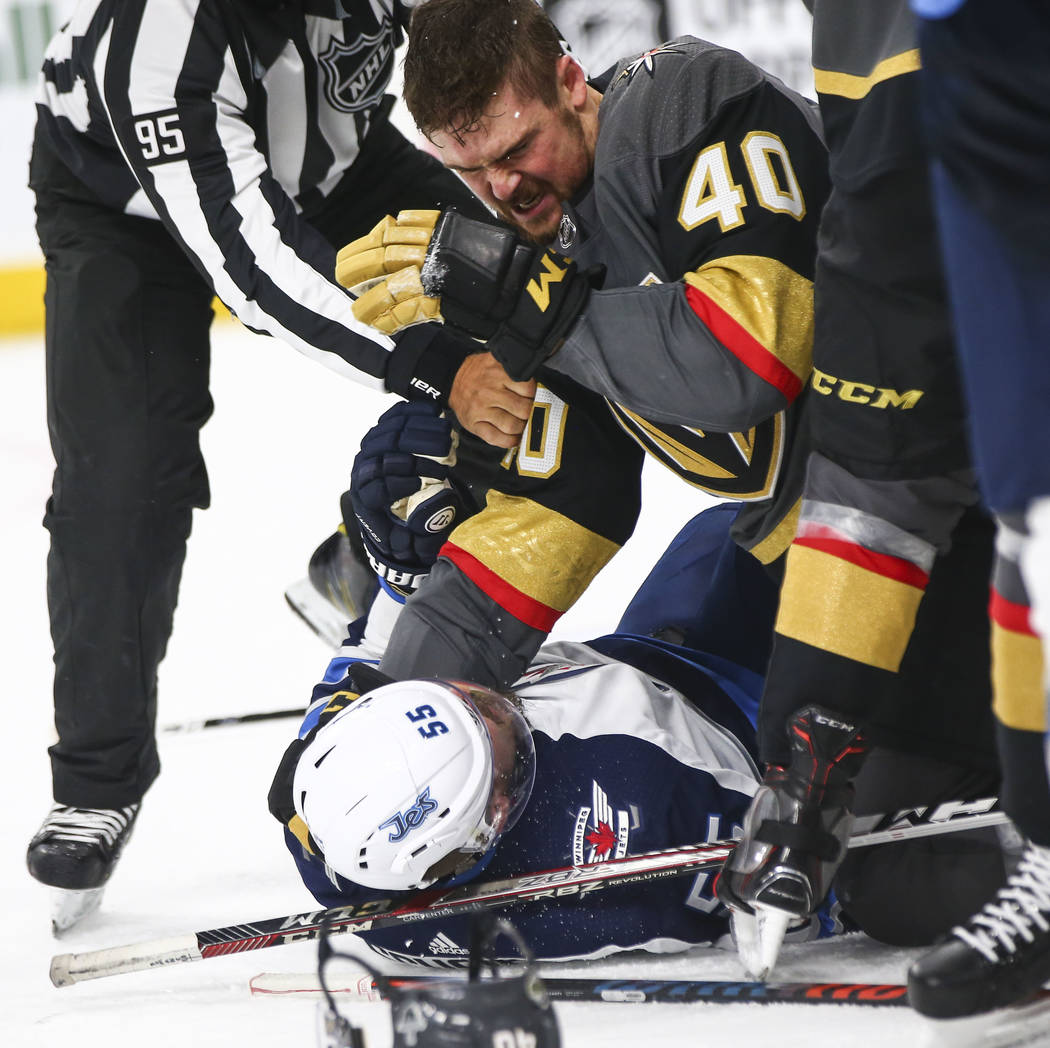 Golden Knights center Ryan Carpenter (40) fights Winnipeg Jets center Mark Scheifele (55) during the second period of Game 3 of the NHL Western Conference finals hockey playoff series at T-Mobile ...