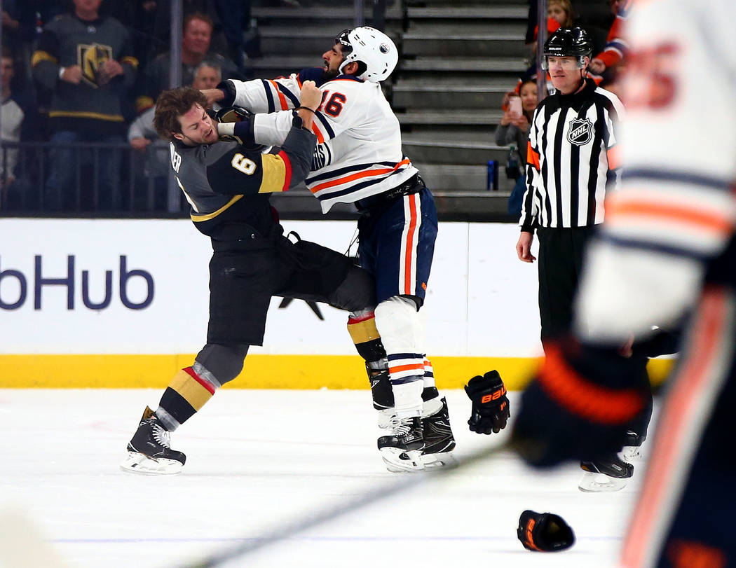 Golden Knights defenseman Colin Miller (6) fights with Edmonton Oilers left wing Jujhar Khaira (16) during an NHL game at T-Mobile Arena in Las Vegas on Thursday, Feb. 15, 2018. Chase Stevens Las ...
