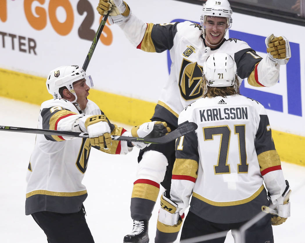 Golden Knights right wing Reilly Smith (19) and center Jonathan Marchessault (81) celebrate a goal by center William Karlsson (71) during the third period of Game 3 of an NHL hockey first-round pl ...
