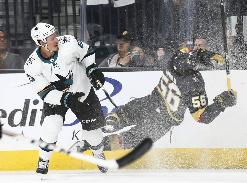 Golden Knights left wing Erik Haula (56) gets tripped up by San Jose Sharks defenseman Justin Braun (61) during the first period of Game 2 of an NHL hockey second-round playoff series at T-Mobile ...